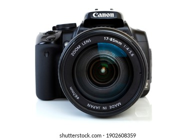 PRAGUE, CZECH REPUBLIC - December 20, 2007: Canon 400D Digital Single Lens Reflex Camera isolated on white background.