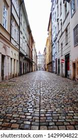Prague, Czech Republic - December 2012 Cobblestones pave this deserted Prague, Czech Republic alley.