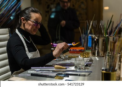 PRAGUE, CZECH REPUBLIC - DECEMBER, 2016: Woman - master of stone carving working in a workshop.