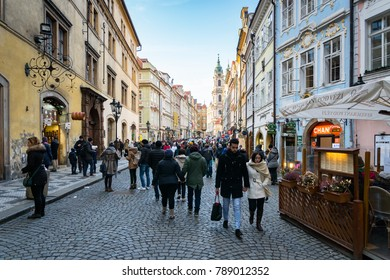 Prague, Czech Republic -December 2017: Prague Old Town street view with people walking by. Prague Old Town is a popular destination with tourists visiting.