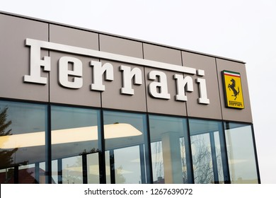 PRAGUE, CZECH REPUBLIC - DECEMBER 23 2018: Ferrari N. V. italian luxury sports car manufacturer company logo in front of dealership building on December 23, 2018 in Prague, Czech Republic.