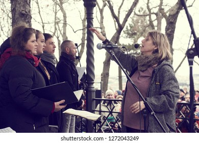 """Prague / Czech Republic - december 23, 2018: Musicians and people singing the """"Czech Christmas Mass"""" in Letna Park. Classic pastoral mass by Jakub Jan Ryba in 1796. It is also known as Hey, Master!"""
