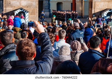 PRAGUE, CZECH REPUBLIC - DECEMBER 23, 2015 : Czechia people and foreigner travelers waiting for the Changing The Guard at gate front of Prague castle in Prague, Czech Republic