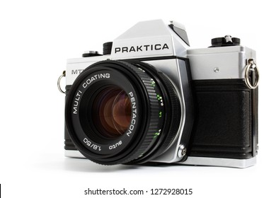 Prague, CZECH REPUBLIC - DECEMBER 24, 2018: Old SLR camera Praktica MTL5 for 35mm film made by German company Pentacon between 1983 and 1985 laid on white background