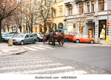 Prague, Czech Republic, December 24, 2016: Horseback riding in a coach in Prague. Entertainment of tourists in Christmas Europe. Christmas in Europe.