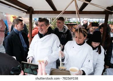 PRAGUE, CZECH REPUBLIC - DECEMBER 24: Andrej Babis / Prime minister / Adriana Krnacova/ Mayor of Prague / Pouring the traditional Christmas soup on December 24, 2017 at Prague, Old Town Square