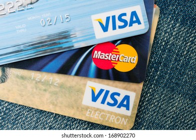 PRAGUE, CZECH REPUBLIC - DECEMBER 27, 2013: Photo of VISA and MasterCard credit cards on blue jeans