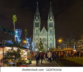 PRAGUE, CZECH REPUBLIC - DECEMBER 5, 2017: Christmas market at Namesti Miru (Peace Square) in front of St. Ludmila Church in night. Traditionally, it is the first Christmas market of the season.