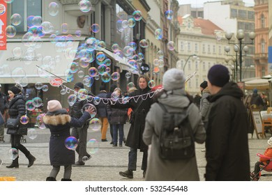 Prague, Czech Republic  - December 5, 2016 : A bubble balloon man showing bubble in the center of Prague city, tourist walking around,vintage shot of happy people enjoying bubble balloon