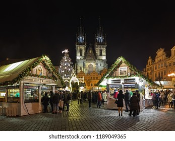PRAGUE, CZECH REPUBLIC - DECEMBER 7, 2017: Christmas market at the Old Town Square with the city's main Christmas tree in night. The Gothic church of Our Lady before Tyn is located on the background.