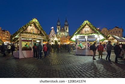 PRAGUE, CZECH REPUBLIC - DECEMBER 7, 2017: Panoramic view of the city's main Christmas market at Old Town Square in twilight. The Gothic church of Our Lady before Tyn is located on the background.