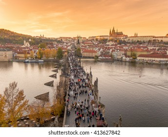Prague, Czech Republic, Europe - 1 NOV 2015: Aerial view of the Charles bridge (Karluv most) over Vltava river full of walking tourists in the old town of Prague at sunset