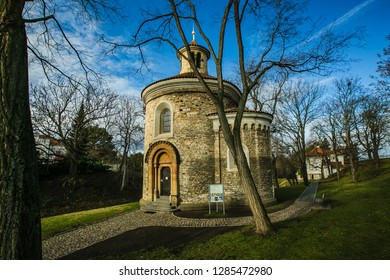 Prague, Czech Republic / Europe - January 16 2019: Medieval rotunda of saint Martin built in 11th century made of stone standing at Vysehrad, green grass, trees, sunny day, blue sky