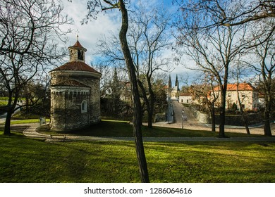 Prague, Czech Republic / Europe - January 16 2019: Medieval rotunda of saint Martin built in 11th century made of stone standing at Vysehrad, the Basilica of St Peter and St Paul in distance