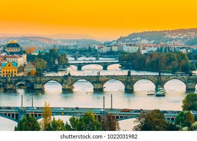 Prague, Czech Republic. Evening Cityscape In Sunset Time. Old Manes Bridge, Charles Bridge In Prague, Czech Republic.