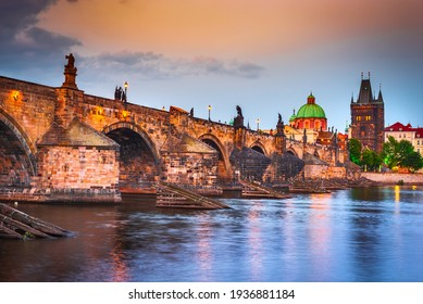 Prague, Czech Republic. The famous Charles Bridge sunset and Stare Mesto, Bohemia travel place in Europe - Shutterstock ID 1936881184