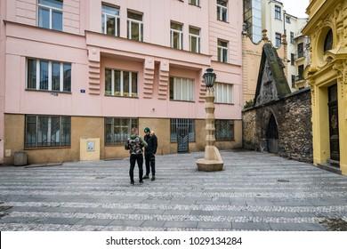 Prague, Czech Republic- February 18, 2018: People are meeting near the Cubist Lamp Post in Prague, Czech Republic