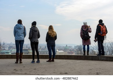 PRAGUE, CZECH REPUBLIC - FEBRUARY 20: Tourists are viewing the town panorama from one of observation points in Letna Park on February 20, 2015 in Prague, Czech Republic.