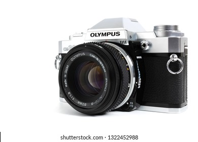Prague, CZECH REPUBLIC - FEBRUARY 21, 2019: Olympus OM-30 a 35mm film SLR camera, launched by Olympus Corporation, laid on white background