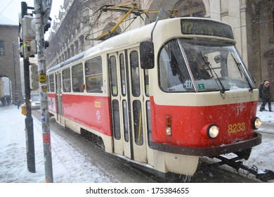 PRAGUE, CZECH REPUBLIC - FEBRUARY 23, 2013: Old red tram in Prague during a heavy snowfall.