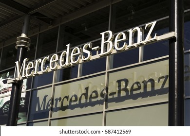 PRAGUE, CZECH REPUBLIC - FEBRUARY 25: Mercedes-Benz car logo on dealership building on February 25, 2017 in Prague, Czech republic. Daimler does deal with Uber on autonomous vehicles fleet.