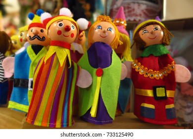 PRAGUE, CZECH REPUBLIC – FEBRUARY 26, 2017: Old-fashioned finger puppet toys, including an elf, on a shop shelf in Prague, Czech Republic.