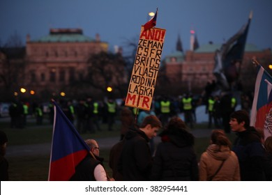 PRAGUE, CZECH REPUBLIC, FEBRUARY 6, 2016: Demonstration for support immigrants, refugees in Prague. A man holding a placard with Zeman, CSFR, Brics, country, family, love, peace, Europe, EU