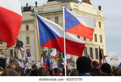 PRAGUE, CZECH REPUBLIC, FEBRUARY 6, 2016: Demonstration against European Union, Islam, immigrants and refugees in Prague, Czech flags, Prague Castle UNESCO, Hradcanske square with people, Europe, EU