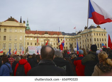 PRAGUE, CZECH REPUBLIC, FEBRUARY 6, 2016: Demonstration against European Union, Islam, immigrants and refugees in Prague, Czech flags, Prague Castle, Hradcanske square with people, Europe, EU