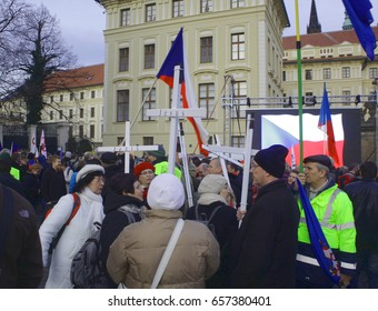 PRAGUE, CZECH REPUBLIC, FEBRUARY 6, 2016: Demonstration christians with white crosses against Islam and immigrants in Prague, Jesus, Hradcanske square Prague Castle, Central Bohemia, Europe, EU
