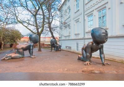 PRAGUE, CZECH REPUBLIC - JANUARY 03, 2018: Three big bronze baby sculptures by Czech artist David Cerny. Park on the Kampa Island in Prague, Czech Republic