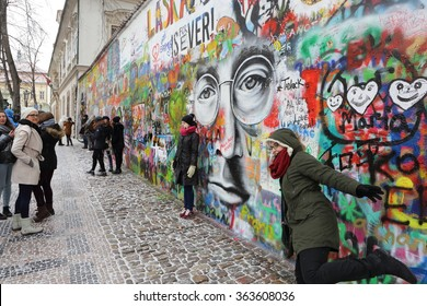 PRAGUE, CZECH REPUBLIC - JANUARY 04: The Lennon Wall since the 1980s is filled with John Lennon-inspired graffiti and pieces of lyrics from Beatles songs on January 04, 2016 in Prague, Czech Republic