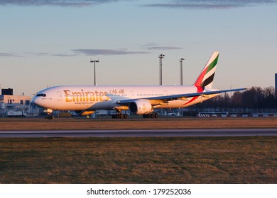 PRAGUE, CZECH REPUBLIC - JANUARY 07: Boeing 777-300 Emirates taxis for take offl in PRG Airport on January 07, 2014. Emirates is an airline based in Dubai.