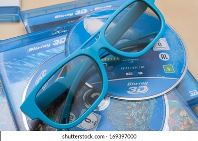 PRAGUE, CZECH REPUBLIC - JANUARY 1, 2014: 3D Technology - Photo of a Plastic 3D Glasses and 3D Blu-Ray Discs