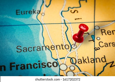 PRAGUE, CZECH REPUBLIC - JANUARY 12, 2019: Red thumbtack in a map. Pushpin pointing at Sacramento city in California, America.