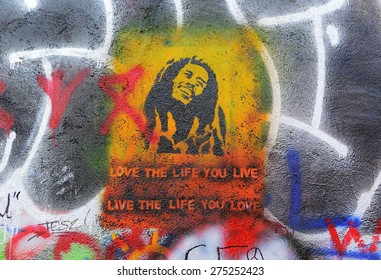 PRAGUE, CZECH REPUBLIC - JANUARY 13: The Lennon Wall since the 1980s is filled with John Lennon-inspired graffiti and pieces of lyrics from Beatles songs on january 13, 2015 in Prague, Czech Republic