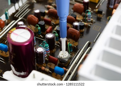 Prague, CZECH REPUBLIC - JANUARY 14, 2019: Ceramic screwdriver is ESD non-conducting, non-metallic and non-magnetic for adjusting trimmers, in front of PCB audio amplifier board