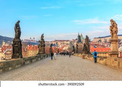 Prague, Czech Republic - January 16, 2015: Pedestrians only Charles Bridge (a.k.a. Stone Bridge, Kamenny most, Prague Bridge, Prazhski most) over Vltava river in Prague, Czech Republic