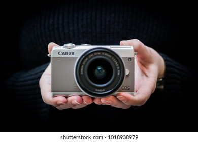 Prague, Czech Republic - January 2018: Latest Canon EOS M100 camera in hands of a young woman - Prague, Czech Republic