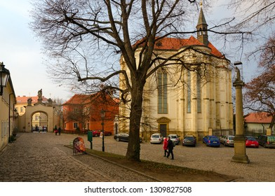PRAGUE, CZECH REPUBLIC - JANUARY 22, 2019: Church of St. Roch (MIRO art gallery), Strahov Monastery. Unidentified people visit monastery courtyard