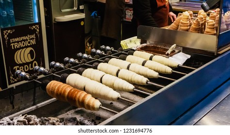 PRAGUE, CZECH REPUBLIC - JANUARY, 28, 2018: Czech national winter street food called trdlo (trdelnik) is being cooked in the square of Prague during Christmas time
