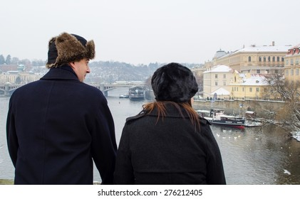 PRAGUE, CZECH REPUBLIC, JANUARY 30, 2015: young couple is watching prague from the charles bridge.