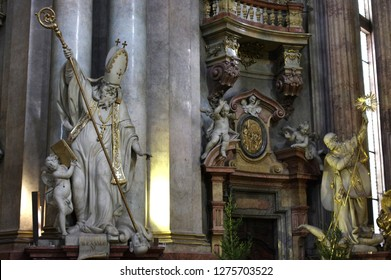 Prague / Czech Republic - January 31 / 218 : St. Cyril of Alexandria holding a crook towards a man and an angel is holding a book at St. Nicholas church