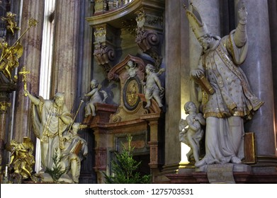 Prague / Czech Republic - January 31 / 218 :  Statue of St. Ioannis holding book and an angel is listening to him at St. Nicholas church