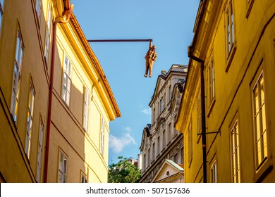Prague, Czech Republic - July 05, 2016: The sculpture of the Man Hanging Out by the famous czech sculptor David Cerny in the old town of Prague