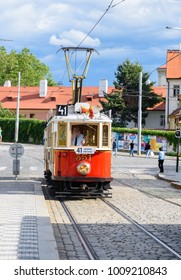 PRAGUE, CZECH REPUBLIC -  JULY 1, 2017: Historical Prague museum tram line 41 and an old tram driver on a cobble stone street in Mala Strana district of Prague on a sunny July afternoon.