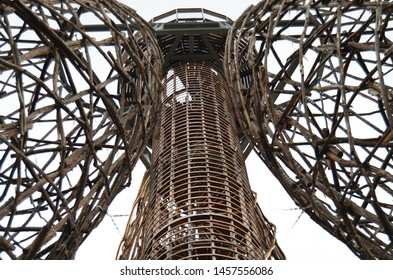 Prague / Czech Republic - July 13 2019: Doubravka XIV. observation tower, view down from bottom to the top. Wooden structure made of locust tree.