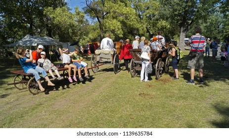 Prague, Czech Republic - July 14, 2018 - Children and adults ride on horse drawn carts in the park of Prague