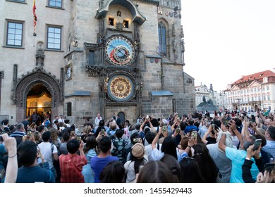 PRAGUE, CZECH REPUBLIC - JULY 17 2019 - Medieval tower clock full of tourist with smartphones. When the clock strikes the hour, the procession of the Twelve Apostles sets in motion.