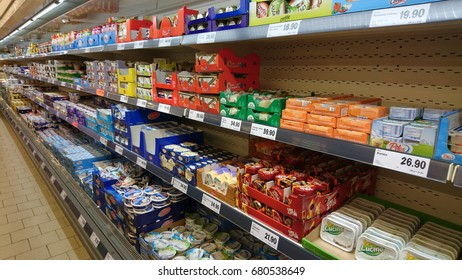 PRAGUE, CZECH REPUBLIC - JULY 19, 2017: Dairy products on shelves in a LIDL supermarket. LIDL is a German discount chain founded in 1973 by German merchant Dieter Schwarz.